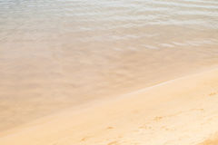 Calm wave and sand. Transparent sea water and beach sand royalty free stock photos