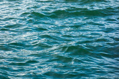 A calm wave of the sea surface. A gentle wave of the sea level at the wharf stock image