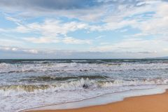 Calm waves on the beach. The storm is coming royalty free stock photography
