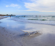 Calm waves of Crescent beach and beach chair. Beach chair on Crescent Beach - Siesta Key vacation Stock Images