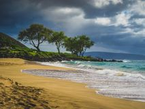 Maluaka Beach. Calm waves on an empty Maluaka Beach on a cloudy day, Maui, Hawaii Stock Images