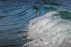 Calm Waves of Malibu. Close-up of calm waves washing onto the shores of secluded Dume Cove beach, Malibu, California Royalty Free Stock Photography