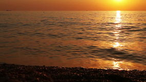Calm waves of the sea at evening stock video footage