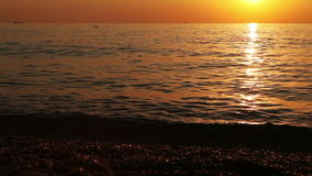 Calm waves of the sea at evening stock video