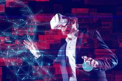 Calm web developer using virtual reality while working with holograms. Virtual reality. Professional creative web developer wearing virtual reality glasses and royalty free stock image