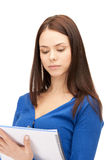 Calm woman with big notepad Royalty Free Stock Photo