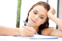 Calm woman with big notepad Stock Photos