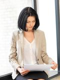 Calm woman with documents. Indoor picture of calm woman with documents Royalty Free Stock Photos
