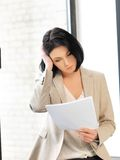 Calm woman with documents Stock Images