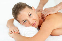 Calm woman enjoying a massage Stock Image