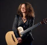 Calm woman with the guitar Stock Photos