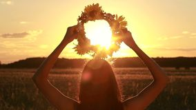 Calm woman holding flower wreath in twilight time stock video
