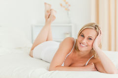 Calm woman lying on her bed Royalty Free Stock Photos