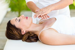 Calm woman receiving reiki treatment. In the health spa stock images