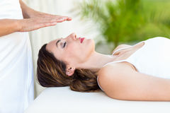 Calm woman receiving reiki treatment Stock Photo