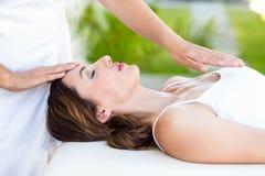 Calm woman receiving reiki treatment Stock Photo