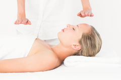 Calm woman receiving reiki treatment Royalty Free Stock Photo