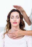 Calm woman receiving reiki treatment Royalty Free Stock Images