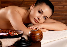 Calm woman relaxing in spa salon Stock Images