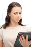 Calm woman with tablet pc computer Royalty Free Stock Photos
