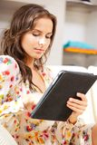 Calm woman with tablet pc computer Royalty Free Stock Image