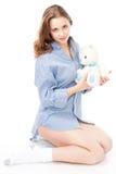 Calm woman with teddy bear Stock Photo
