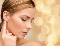 Calm woman touching her ear Royalty Free Stock Photography