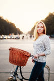Calm woman on a vintage bicycle in the city Stock Image