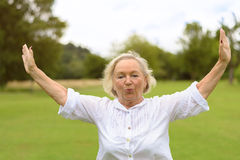 Calm woman in white clothing exercising outside Royalty Free Stock Photos