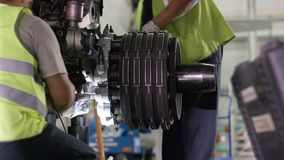 Calm workers controlling aircraft machine and chassis. Aircraft maintenance mechanic inspects plane chassis. Installing stock photos