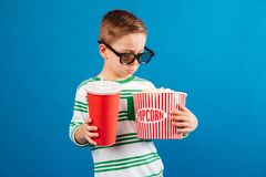 Calm young boy in eyeglasses preparing to watch the film Stock Image