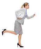 Calm young businesswoman with clock running