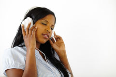 Calm young female listening to music. Close up portrait of a calm young female listening to music while resting Royalty Free Stock Photo