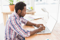 Calm young man sitting in front of a laptop Stock Photo