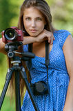 Calm young woman with camera on Stock Image