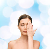 Calm young woman covering face with hand Stock Photography
