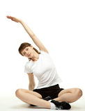Calm young woman doing sport exercises Royalty Free Stock Photography