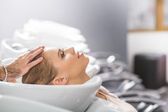 Calm young woman is sitting at hairdressers Stock Image