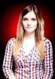 Calm young girl wearing plaid shirt Stock Image