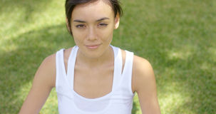 Calm young woman in white blouse with grin Stock Image