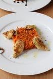 Calmar de bébé avec les carottes caramélisées Photo libre de droits