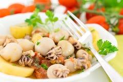 Calmar et poissons de pommes de terre Photo stock