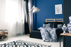 Calming bedroom with cobalt wall Stock Image