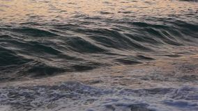 Calming Black sea surf at sunset stock video footage