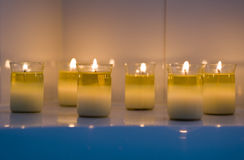 Calming Candles. Small candles burning in a spa to create a calming environment stock images