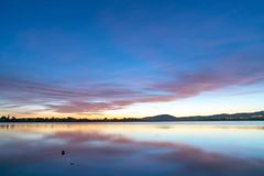 Calming effect of long exposure sunrise. Over bay in pink and blue hues stock image