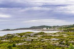 Scandinavian Ocean Bliss. A calming Ocean Vista with a gorgeous cloudscape and rocky island formations in the background and tide pools in the foreground Stock Photography