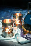 Calming Oil Burner. An oil burner for aromatherapy with candles lit and a breath-taking background Stock Photography