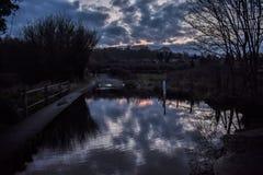 Calming reflective sunset. Very calming bridge into a beautiful sunset Stock Images