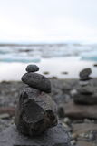 Calming. Tower of stones near ice lake Royalty Free Stock Images